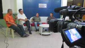 Co -host Rev.  Talha asks Boyet Areno and Ted Aldwin Ong (extreme right)  regarding the stand of the  Iloilo Caucus of Development NGOs (ICODE) on the pork barrel scam